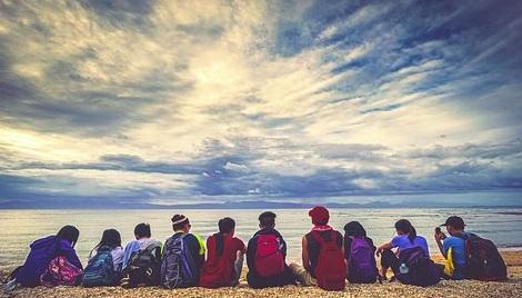 travel group on rimini beach